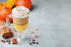 Pumpkin spiced latte or coffee in glass with space for recipe. Autumn, fall or winter hot drink. stock photo