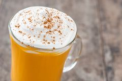 Pumpkin spiced latte on wood Royalty Free Stock Photos