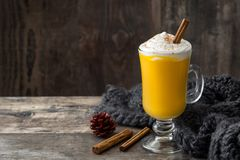 Pumpkin spiced latte on wooden table. Copyspace Royalty Free Stock Photography