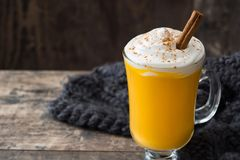 Pumpkin spiced latte on wooden table. Copyspace Royalty Free Stock Photo