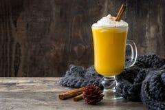 Pumpkin spiced latte on wooden table. Copyspace Stock Photo