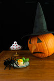 Pumpkin and Spider. Pumpkin and eyeballs watch a spider Royalty Free Stock Photo