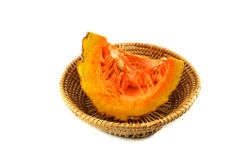 Pumpkin split on basket Royalty Free Stock Photos