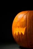 Pumpkin: Spooky Jack-O-Lantern On Black Background Royalty Free Stock Image