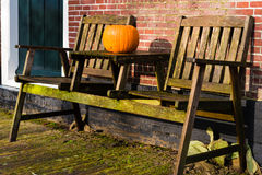 Pumpkin standing on vintage wooden table Stock Photography