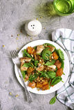 Pumpkin stew with chicken,spinach and walnuts.Top view. Stock Images