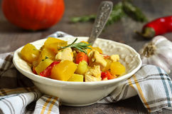 Pumpkin stewed with chicken and rosemary. Stock Photography