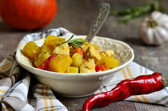 Pumpkin stewed with chicken and rosemary. Royalty Free Stock Photo