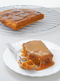 Pumpkin sticky pudding with toffee caramel sauce. Piece of pumpkin sticky pudding with toffee caramel sauce Stock Image