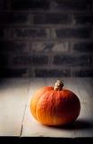 Pumpkin. Stone wall. Halloween, autumn, wooden background. Royalty Free Stock Photos