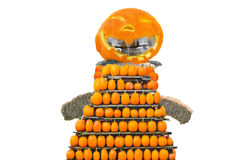 Pumpkin, straw figure with teeth. Figure of straw bales with pumpkin head, body and teeth for Halloween Party Royalty Free Stock Images
