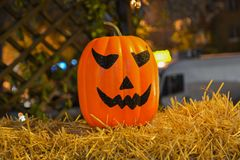 Pumpkin in straw. Pumpkin Halloween party decoration background Stock Photo