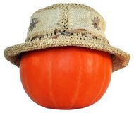 Pumpkin in the straw ladies' hat Royalty Free Stock Photography