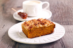 Pumpkin streusel cake slice. On plate and coffee royalty free stock photo