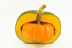 Pumpkin stuffed. Picture of orange mini pumpkin stuffed inside half of bigger green pumpkin Royalty Free Stock Photo