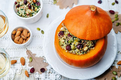Pumpkin stuffed with millet, spinach, dried cranberries, mushroo Royalty Free Stock Images
