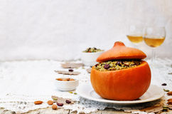 Pumpkin stuffed with millet, spinach, dried cranberries, mushroo Stock Photos