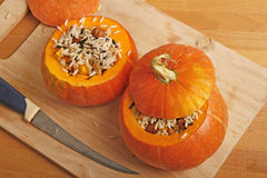 Pumpkin stuffed with rice Stock Image