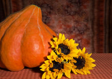 Pumpkin and sunflower Stock Photography