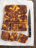 Pumpkin swirl brownies. Cut into pieces Royalty Free Stock Photos