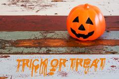 Pumpkin on table with words 'trick or treat' Stock Image