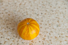 Pumpkin on a table. Yellow pumpkin on a table stock photography