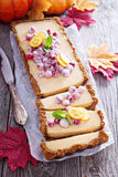 Pumpkin tart on gingerbread crust. With candied cranberry stock images