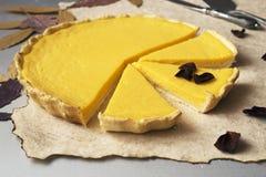 Pumpkin Tart. Outdoor pie with sweet pumpkin cream filling Royalty Free Stock Photography