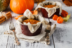 Pumpkin tart surrounded by colorful fall leaves and pumpkins stock photos