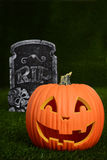 Pumpkin and tombstone Stock Images