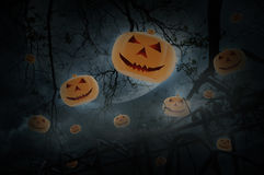 Pumpkin toy fly over old fence, dead tree, moon and cloudy sky, Stock Photography