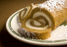 Pumpkin Treats. Pumpkin roll with cream cheese filling and powdered sugar on top Stock Photo