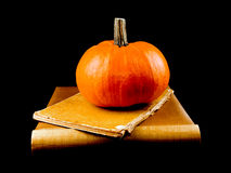 Pumpkin with two old books - Halloween Stock Photo