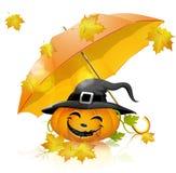 Pumpkin under a yellow umbrella Royalty Free Stock Photo