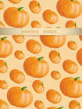 Pumpkin vector seamless pattern on the beige background Royalty Free Stock Images