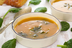 Pumpkin vegetable soup with spinach Stock Photos