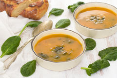 Pumpkin vegetable soup with spinach and corn bread Stock Images