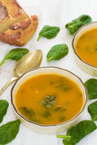Pumpkin vegetable soup with spinach and corn bread Stock Photos