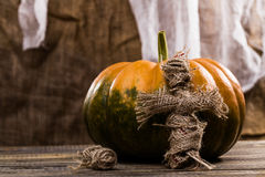 Pumpkin with voodoo doll Royalty Free Stock Image
