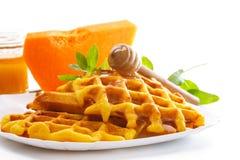Pumpkin waffles with honey Stock Photo