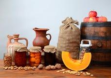 Pumpkin, walnuts, apples, and jam into jars Stock Photography