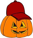 Pumpkin Wearing A Baseball Cap Royalty Free Stock Photos