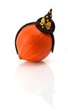 Pumpkin wearing a halloween costume headbands. Witch hat, bat and spider. Stock Photos