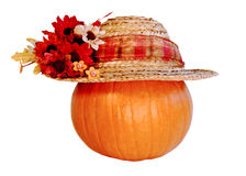 Pumpkin Wearing A Hat. Pumpkin wearing a straw hat Royalty Free Stock Photography