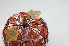 orange fall pumpkin decoration on a white background  Royalty Free Stock Image
