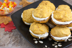 Pumpkin Whoopie Pies. Pumpkin flavored whoopie pie cakes with whipped vanilla cream filling Royalty Free Stock Image