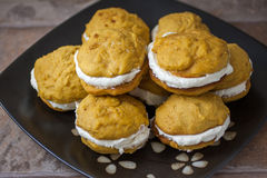Pumpkin Whoopie Pies. Pumpkin flavored whoopie pie cakes with whipped vanilla cream filling Royalty Free Stock Images