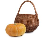 Pumpkin and wicker basket Royalty Free Stock Images