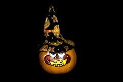 Pumpkin witch. An decorative pumpkin on an black back ground Stock Image
