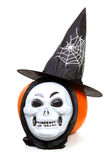 Pumpkin with witch hat and mask. Pumpkin with witch hat and scary mask over white background stock images